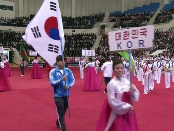North Korea have allowed South Korean athletes to march alongside their flag at a weightlifting event in Pyongyang