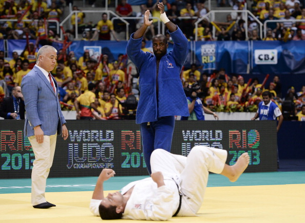 Teddy Riner (blue) of France celebrates his victory against Rafael Silva of Brazil in the over 100kg final category at the World Championships