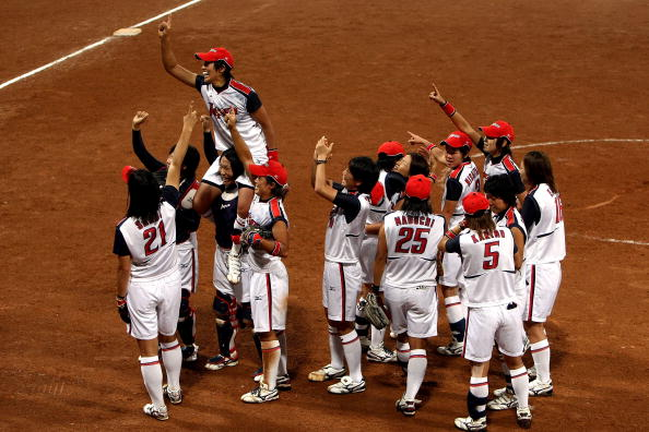 Yukiko Ueno (top) led her Japan team to break the American stranglehold on the Olympic softball title in 2008
