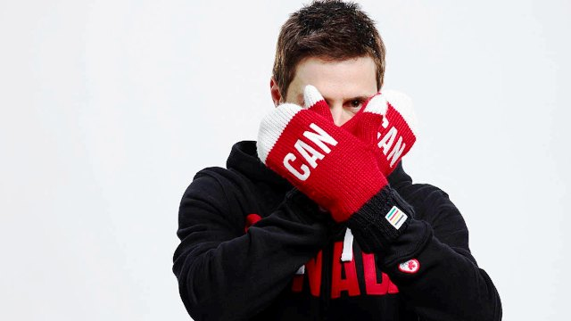 Vancouver 2010 gold medallist Alexandre Bilodeau shows off his Sochi 2014 red mittens