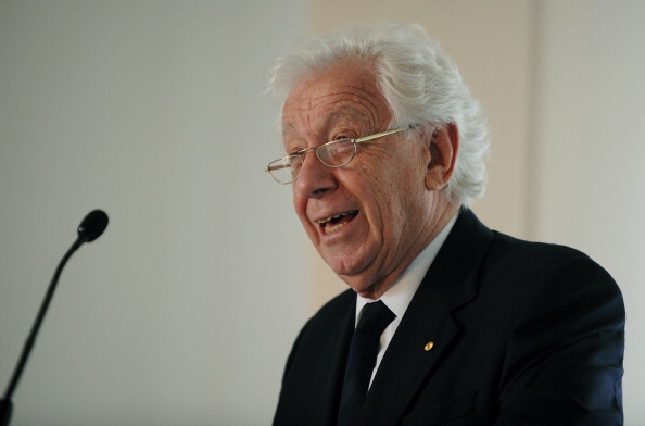 FFA chairman Frank Lowy has warned Sepp Blatter that he could 'make a bad situation worse' by switching the 2022 FIFA World Cup to the northern hemisphere winter