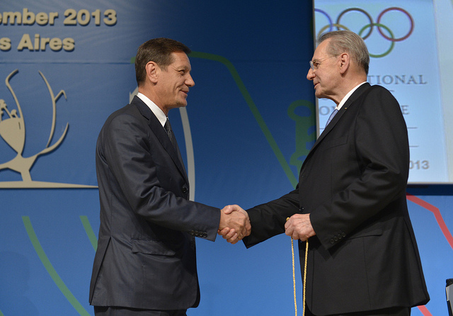 Russian Olympic Committee President Alexander Zhukov is congratulated by Jacques Rogge after officially becoming an International Olympic Committee member