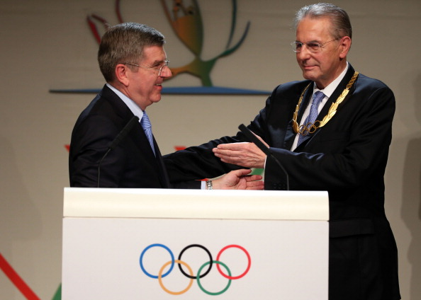 Thomas Bach is congratulated after his election as IOC President by Jacques Rogge, who received the Olympic Order to mark his 12 years in charge