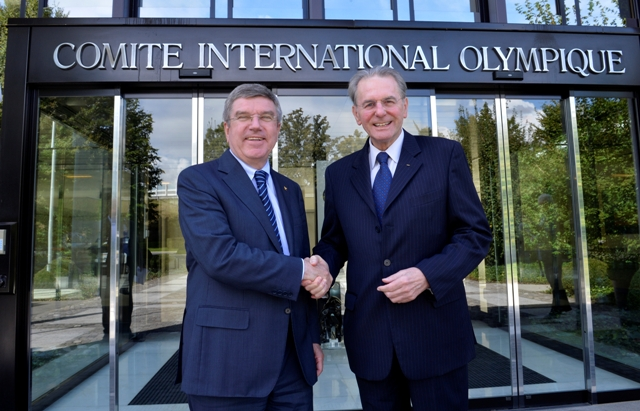 New IOC President Thomas Bach meets predecessor Jacques Rogge outside the organisation's headquarters in Lausanne
