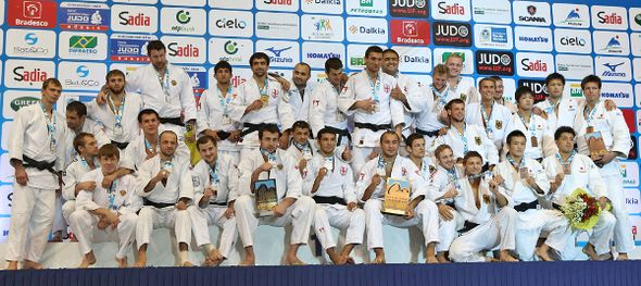 The medallists from the men's team event celebrate their success at the World Championships