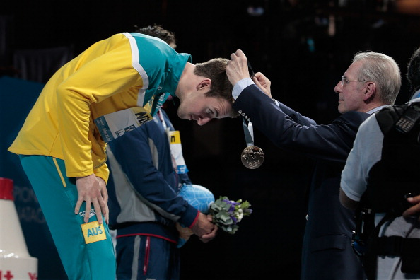 Jacques Rogge, pictured giving James Magnussen of Australia his gold medal after winning this year's world 100m freestyle swimming title, has always made a point of putting athletes centre-stage