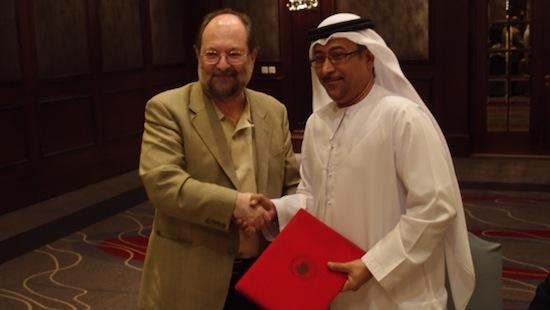 Adham Sharara congratulates Dawoud El-Hajri on Dubai's winning bid to host the 2013 ITTF World Tour Grand Finals