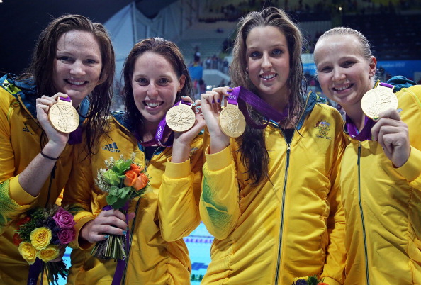 Alicia Coutts, Melanie Schlanger, Brittany Elmslie, and Cate Campbell celebrate winning Australia's solitary swimming gold medal at London 2012 in the 4 x 100m freestyle relay