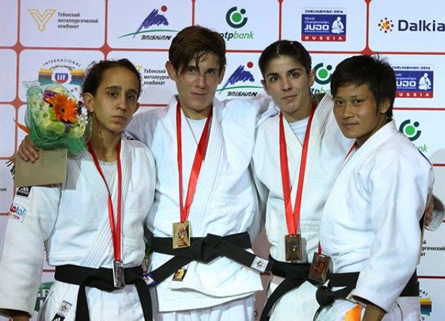 Athens 2004 bronze medal winner Ilse Helen (second from left) celebrates her record breaking victory in Tashkent