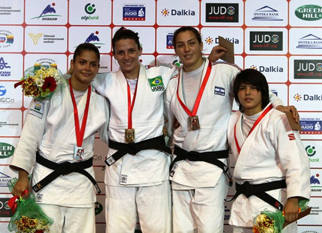 Barbara Timo (second from left) made it three gold medals on the day for Brazil