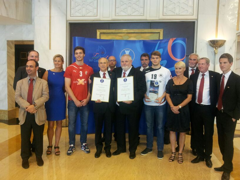 Denmark and Germany handball officials celebrate after their joint bid was chosen to host the 2019 men's World Championships