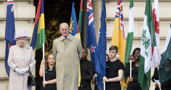 Elizabeth II and the Duke of Edinburgh in front of a parade of flags from all 70 Commonwealth Games participants