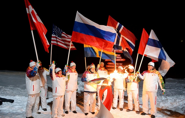 Explorer Artur Chilingarov lights the Flame at the North Pole