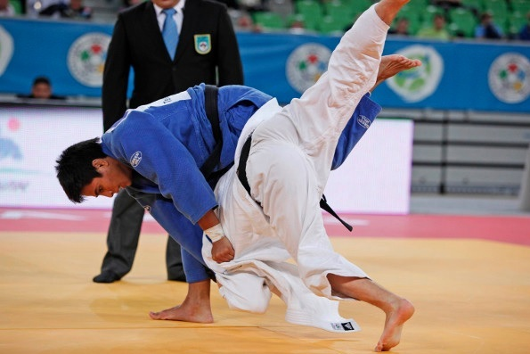 France's Vincent Manquest (blue) led France to their first gold of the Judo World Junior Championships in Ljubljana