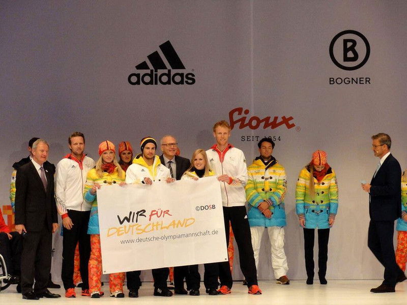 Olympic beach volleyball champions Julius Brink (second from left) and Jonas Reckermann (fourth from right) handed over the flag that had flown at the Athletes' Village in London 2012 as a good luck charm to the Sochi 2014 athletes