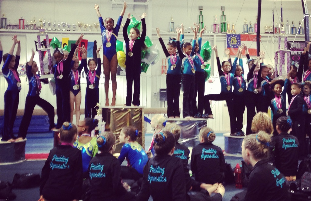Hundreds of medals were doled out like candy at my nine-year-old daughter's gymnastics competition recently