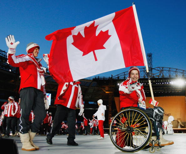 Ice Sledge Hockey star Todd Nicholson, pictured carrying  the Canadian flag at Turin in 2006 before he helped the team win the gold medal, will be another speaker