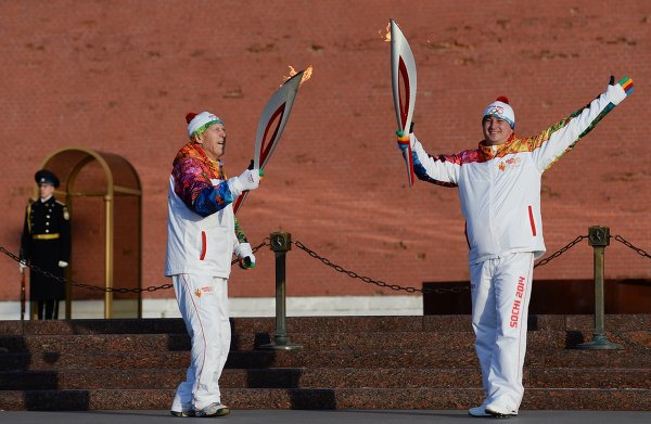 Georgia is angry that Ivan Nechayev (right), a military pilot from its 2008 war with Russia, was among 10 people chosen to carry the Sochi 2014 Olympic Torch when it arrived in Moscow earlier this month
