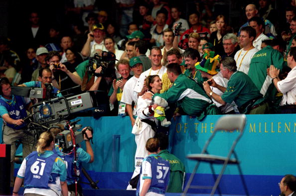 Lauren Burns celebrates after winning Australia's first and, to date only, Olympic taekwondo title in front of a home crowd in Sydney