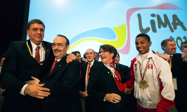 Peruvian officials, including National Olympic Committee President José Quiñones (left) and Mayor  Susana Villarán, celebrate with PASO head Mario Vázquez Raña after being awarded the 2019 Pan American and Parapan Games