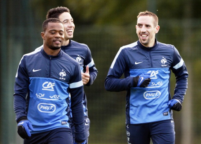 Members of the French squad share a joke ahead of their final Group I World Cup qualifying match against Finland