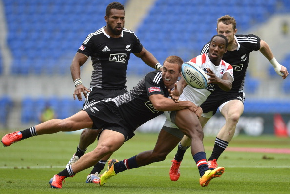 New Zealand swamp speed merchant Carlin Isles of the USA as the new World Sevens Series season gets underway on the Gold Coast