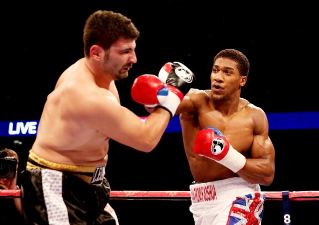 Olympic champion Anthony Joshua looked impressive on his professional debut against Italian Emanuele Leo in London