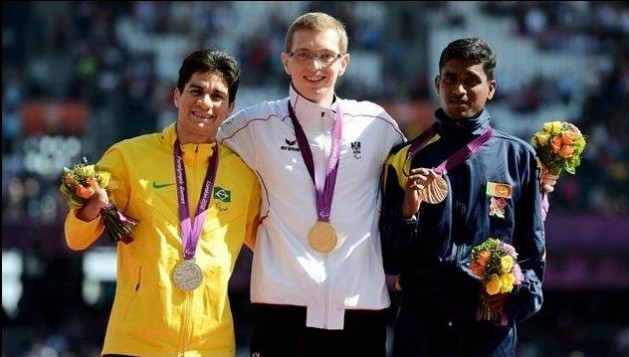 Pradeep Sanjaya (far right) won Sri Lanka's first-ever medal in the Paralympics when he finished third in the T46 400m at London 2012