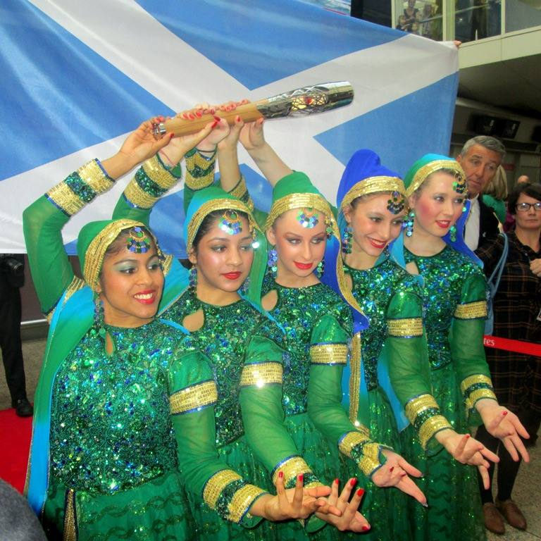 There was a touch of Bollywood glamour as the Queen's Baton left Glasgow Airport for New Delhi
