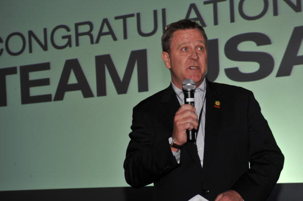 Scott Blackmun pictured speaking at the last Winter Olymics in Vancouver in 2010 has insisted that the USOC rule change is not an attempt to put pressure on the Russians