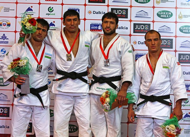 Sherali Juraev (second from left) sent the home crowd home happy for the second day in-a-row with victory in the under 90kg class