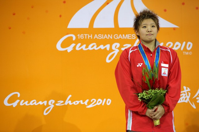 Singapore swimmer Tao Li celebrates winning the gold medal in the 50 metres butterfly at the 2010 Asian Games in Guangzhou