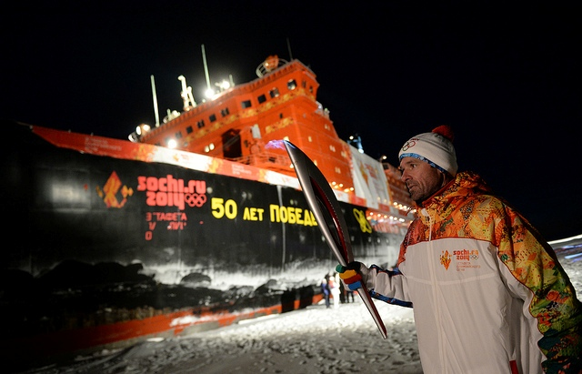 The Torch is carried close to the icebreaker which made the journey to the North Pole