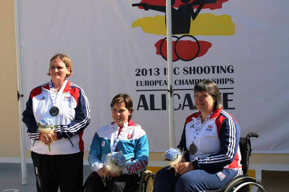 Veronika Vadovicova (centre) celebrates her second indivdual gold medal at the 2013 IPC Shooting European Championships