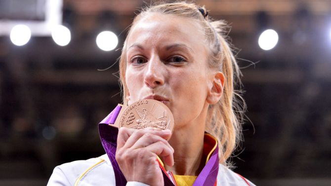 Charline Van Snick celebrates winning her Olympic bronze medal at London 2012
