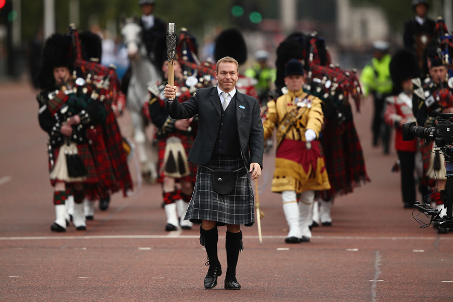 Sir Chris Hoy carries the Baton on the Mall to Buckingham Palace to begin the Ceremony