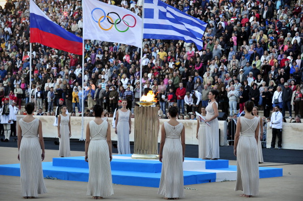 The Greek and Russian flags, along with the one of the International Olympic Committee, fly in the Panathenaic Stadium in Athens as Sochi 2014 prepare to receive the Olympic Torch