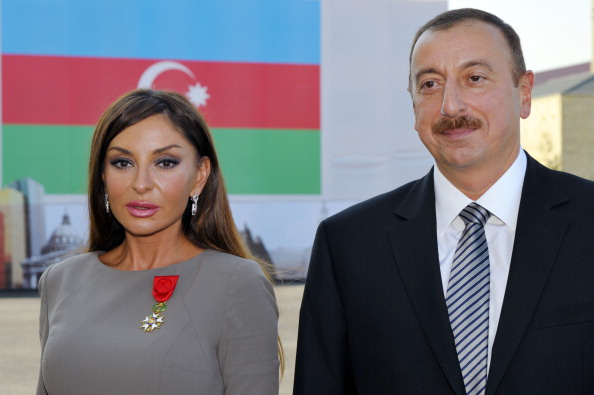 Azerbaijan's President Ilham Aliyev (R) poses beside first lady Mehriban Aliyeva after she was awarded with the Legion d'Honneur medal from the hands of French President Nicolas Sarkozy. © Getty Images