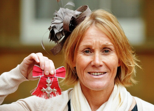 BPA director of sport and Chef de Mission to the ParalympicsGB at Sochi 2014 Penny Briscoe shows off her MBE at Buckingham Palace © Getty Images