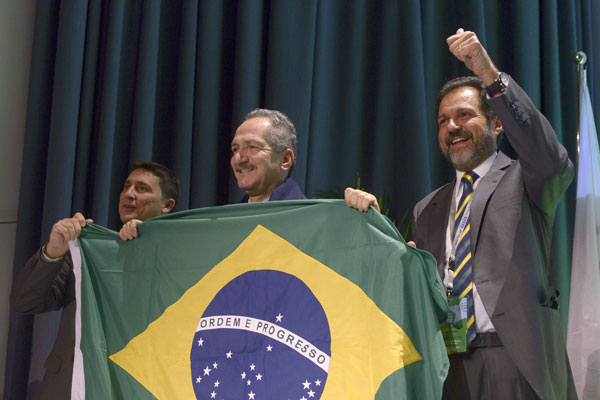 Luciano Cabral, President of the Brazilian University Sports Confederation, Aldo Rebelo, Brazil's Sports Minister, and Angelo Queiroz, Governor of the Federal District of Brasilia, celebrate the capital being awarded the 2019 Summer Universiade