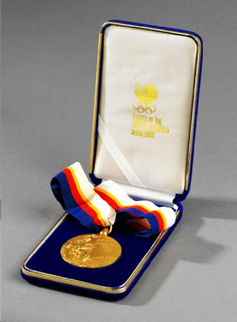 Erika Salumae's 1988 Olympic gold medal sold for £25000 at an auction in London