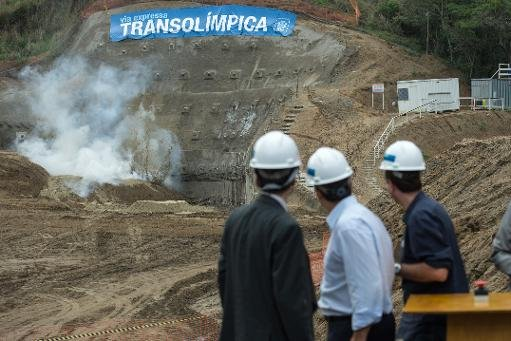 Games dignitaries observe the creation of the new tunnel on the Transolimpica expressway which will link the city centre with other Games sites