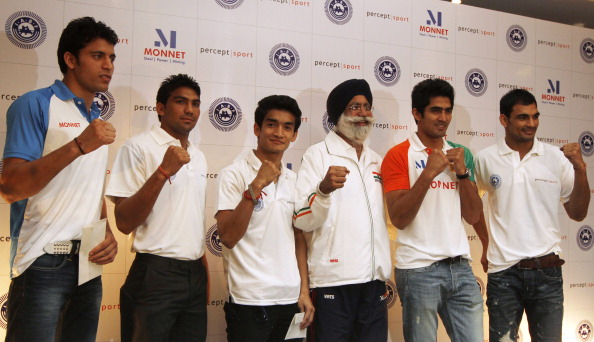 Gurbaksh Singh Sandhu, pictured here with India's boxers in the build-up to London 2012, has been persuaded to carry on until Rio 2016 @Hindustan Times via Getty Images