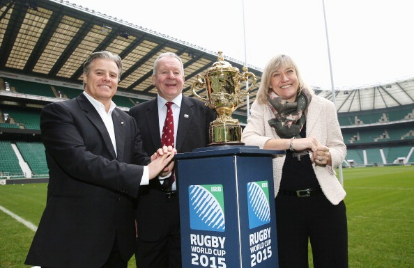 IRB chief executive Brett Gosper, RFU chairman Bill Beaumont and England 2015 chief executive Debbie Jevans pose with the Webb Ellis Cuo at today's ticketing announcement © Getty Images