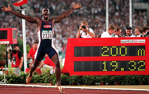American Michael Johnson celebrates breaking the world record in the 200 metres in the Centennial Olympic Stadium at Atlanta, adding it to the gold medal he had won in the 400m