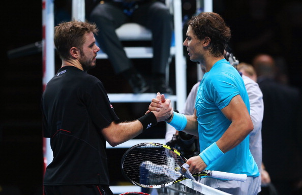 Nadal made sure he would end the season as world number one after securing a place in the semi final of the ATP World Tour Finals with a win over Stanislas Wawrinka