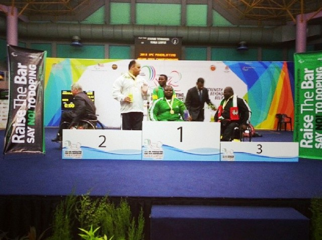 Nigerian Abdulazeez Ibrahim (centre) receives his gold medal in the under 97kg category
