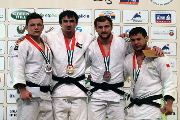 Sergiu Toma stands on top of the podium after securing a second gold medal of the week for the UAE ©IJF