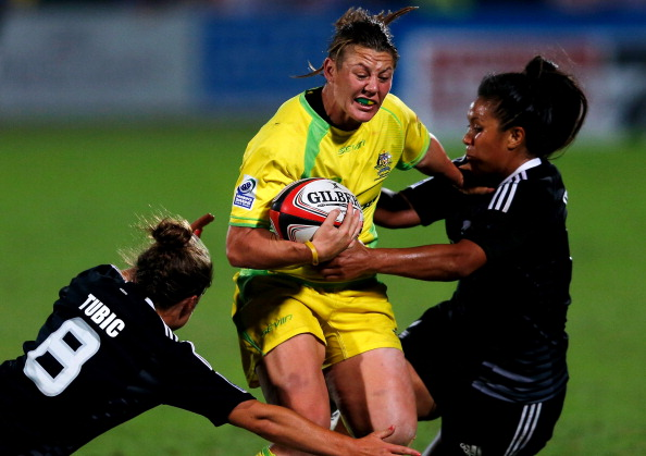 Australia captain Sharani Williams battles with the opposition as her teams begins its fightback ©Getty Images