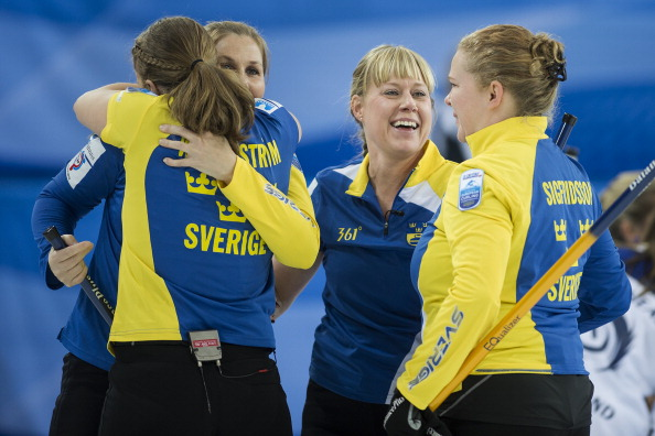 Sweden celebrate following their victory over world champions Scotland ©AFP/Getty Images